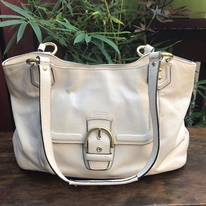 COACH white leather bag with gold hardware.